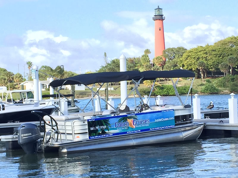 Conch Cruises Boat and Jupiter Lighthouse